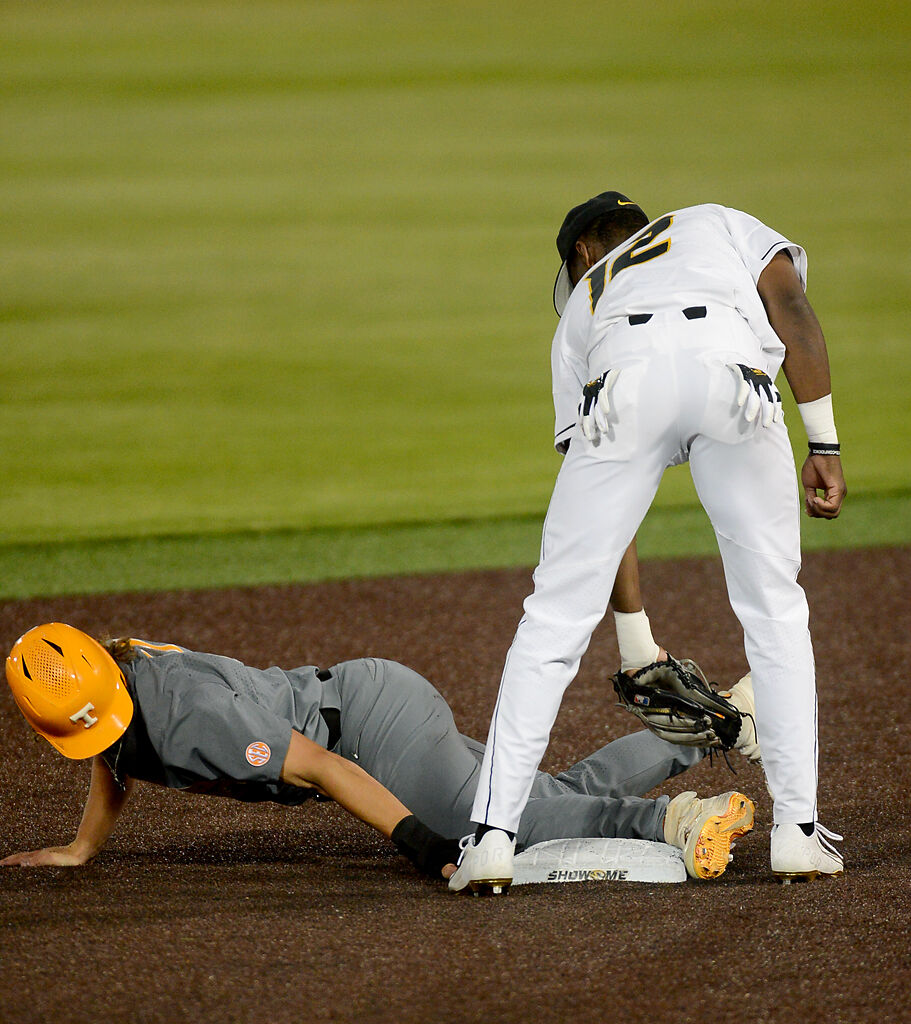 Joshua Day tries to tag out Tennessee's Jordan Beck