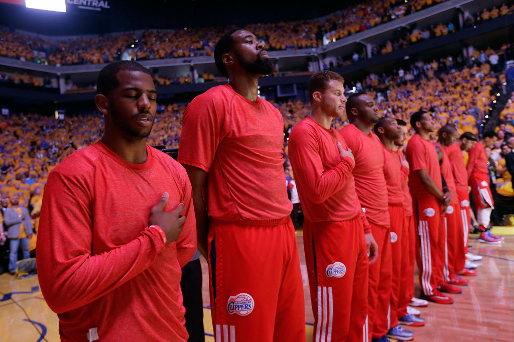 Los Angeles Clippers protest Sterling's racial remarks by wearing warmup jerseys inside out