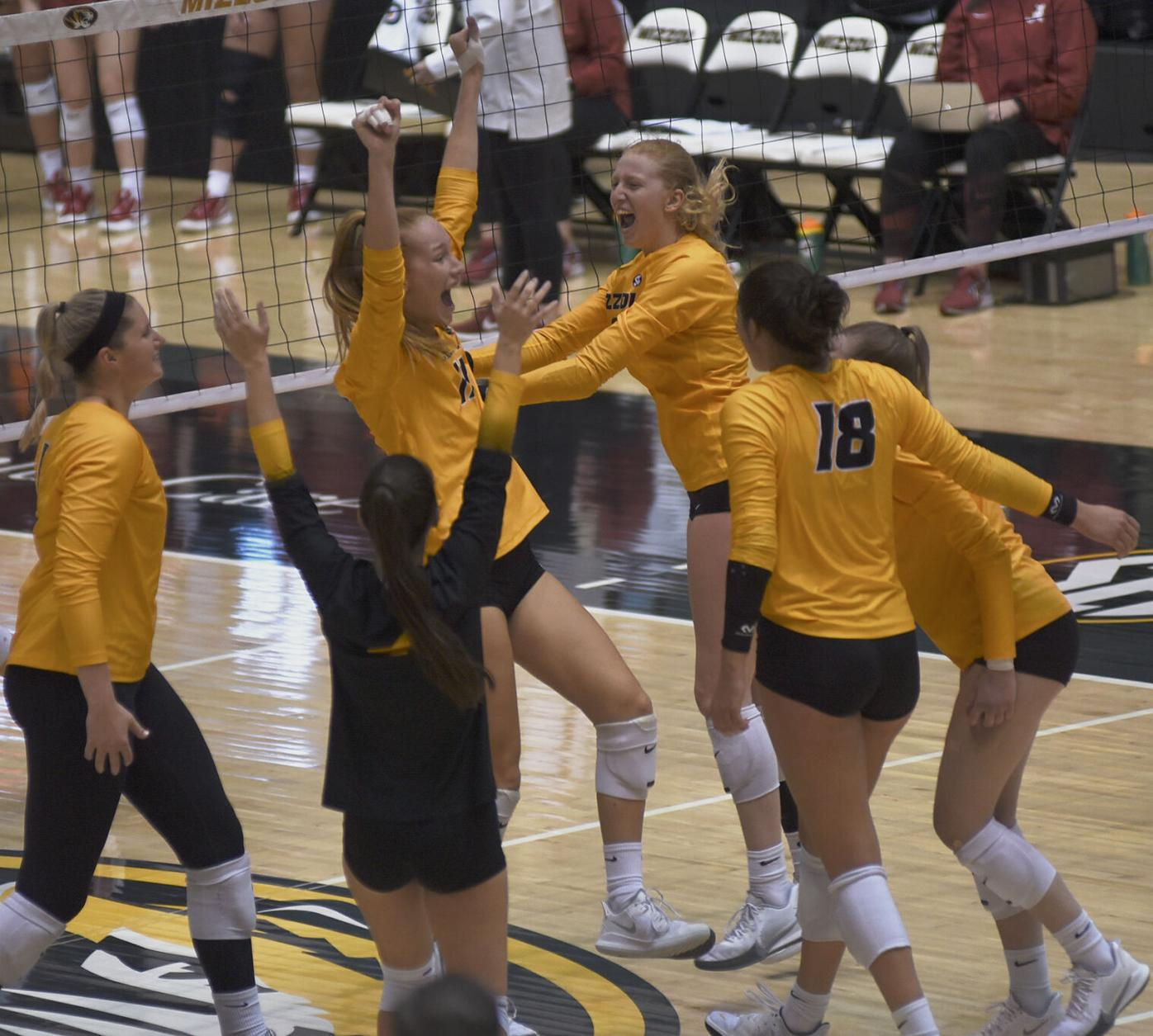 Missouri Tigers celebrate a point scored during the fourth set of the volleyball game