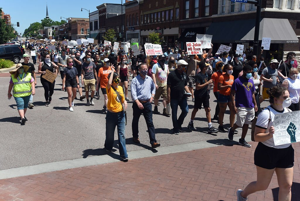 Protesters march down Broadway during the NAACP Rally on Saturday.