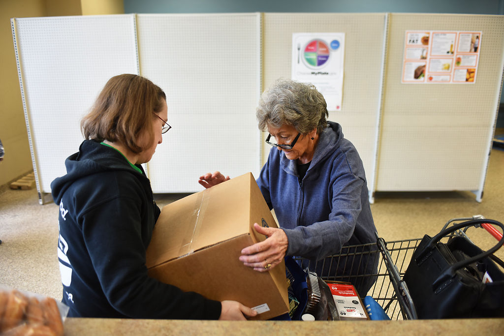 Gail Friedrich takes her Commodity Supplemental Food Program box