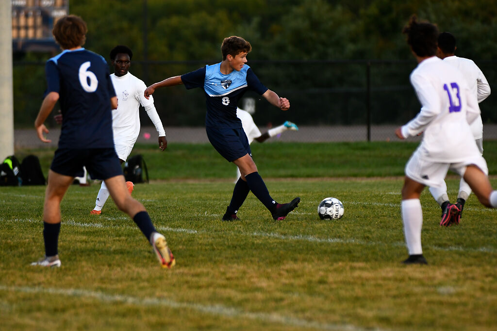 Tolton sophomore August Schultz attempts a goal pass at the game against Hickman on Monday in Columbia.