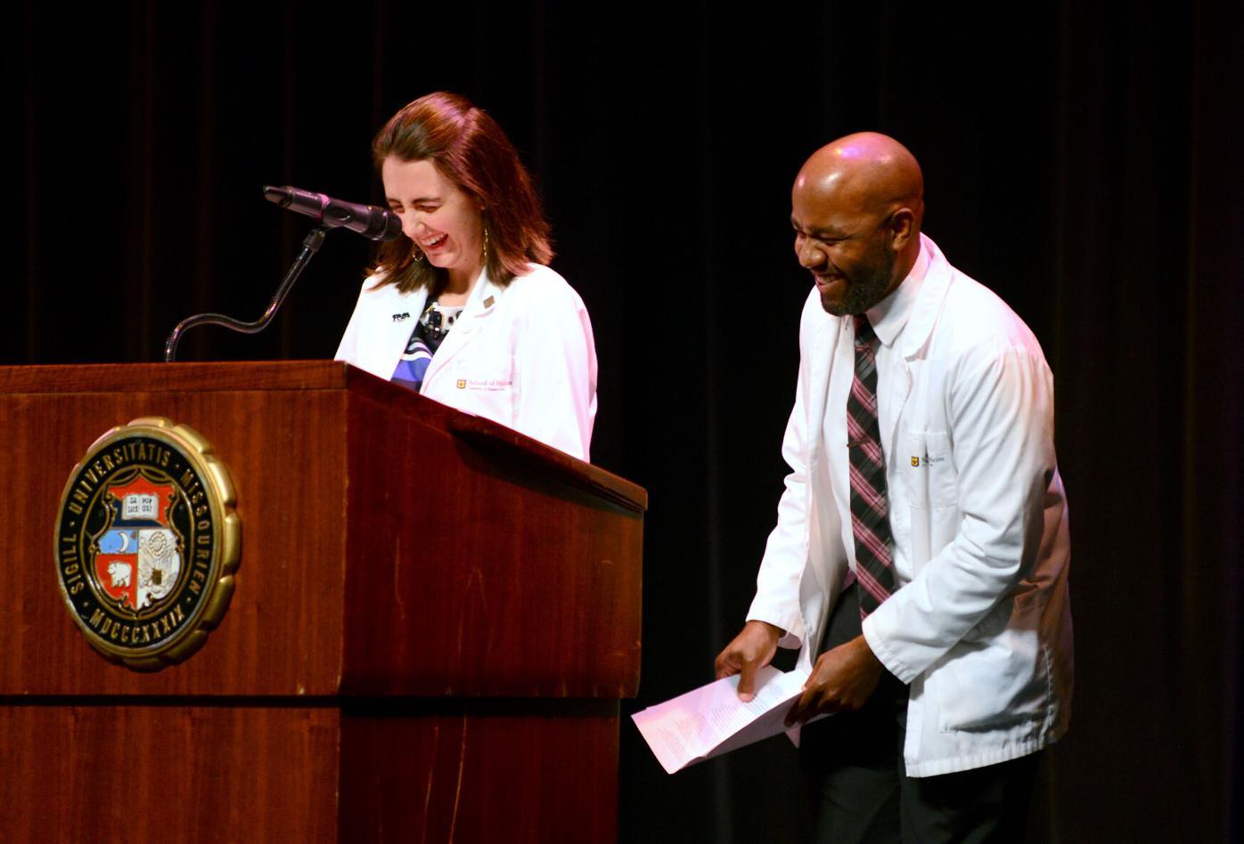 Samantha Unangst and Taylor Brooks address new students