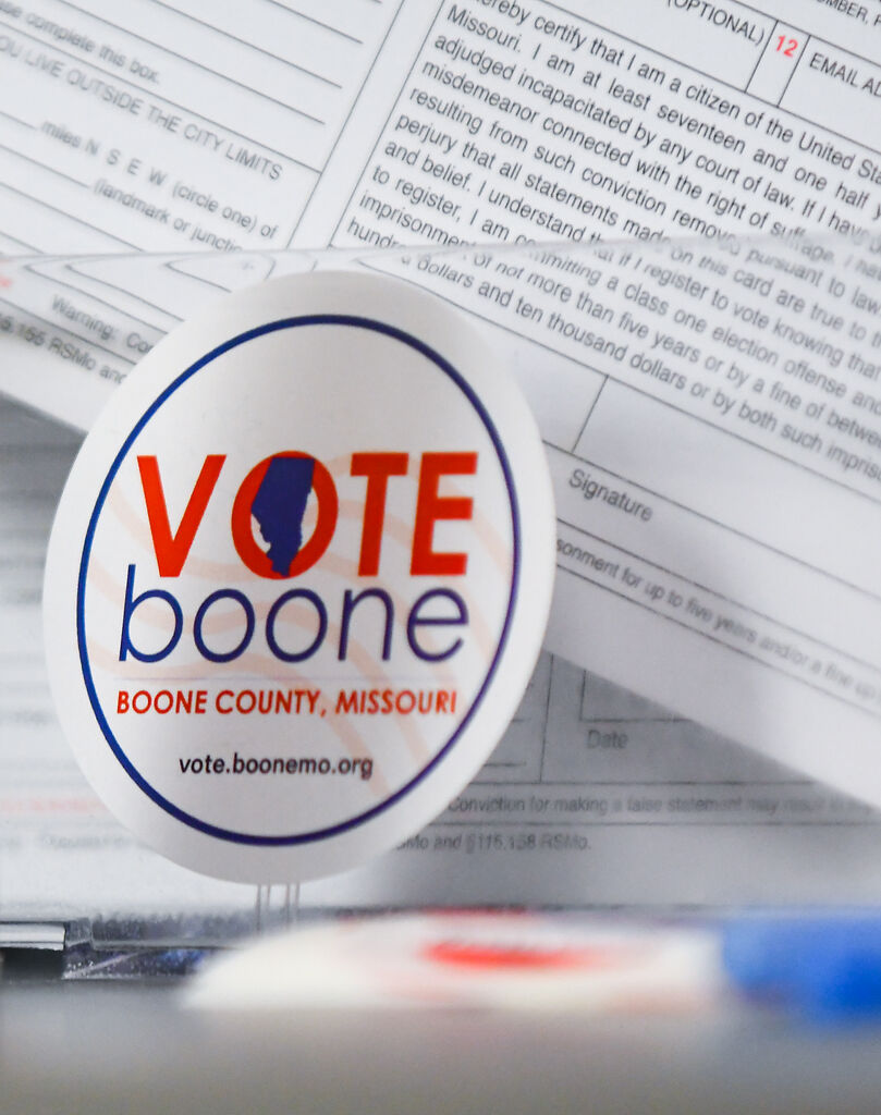 """A sticker that reads """"Vote Boone"""" is among tools and forms"""