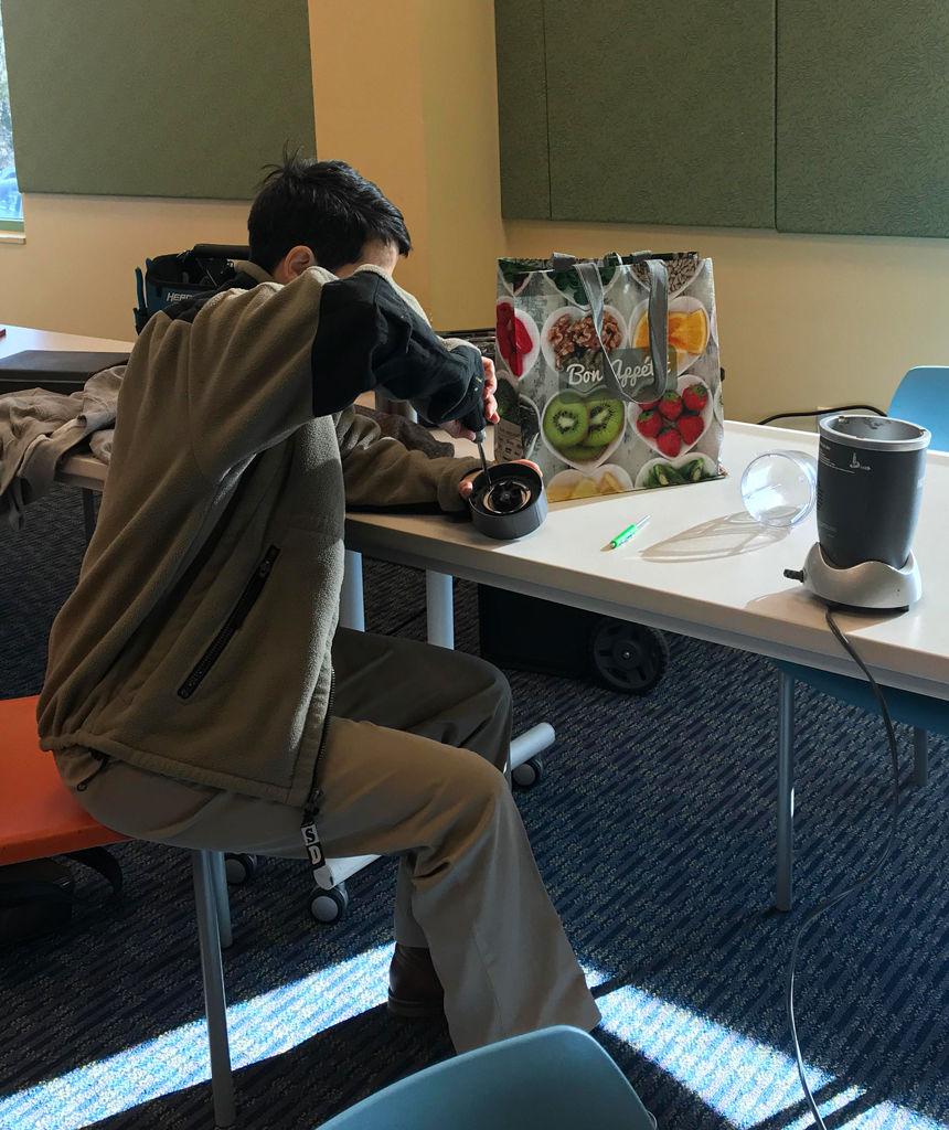 Carolyn Sullivan works to take apart her NutriBullet