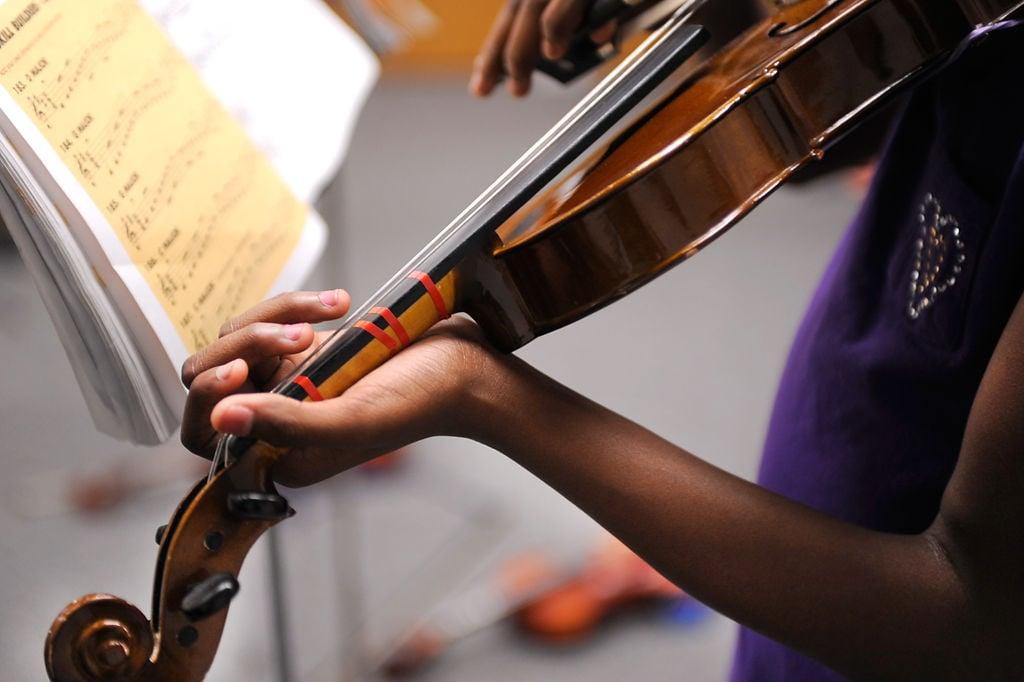 A'Taliya Bass practices violin