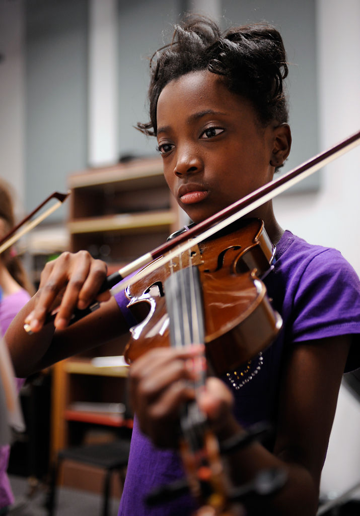 A'Taliya Bass plays violin with Mizzou String Project