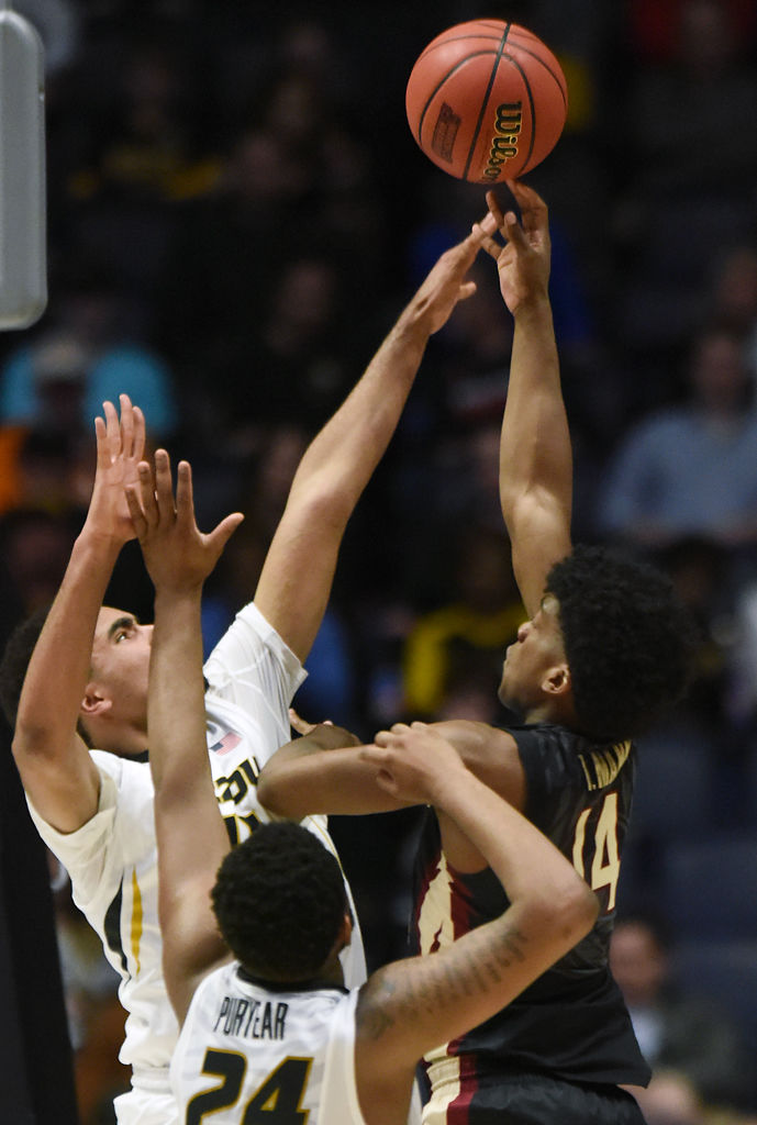 Missouri forwards Jontay Porter and Kevin Puryear try to block a shot