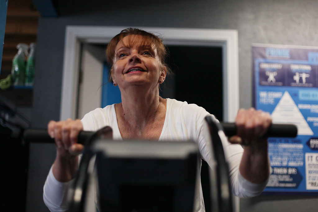 Susan Jones, 59, warms up on a stationary bike