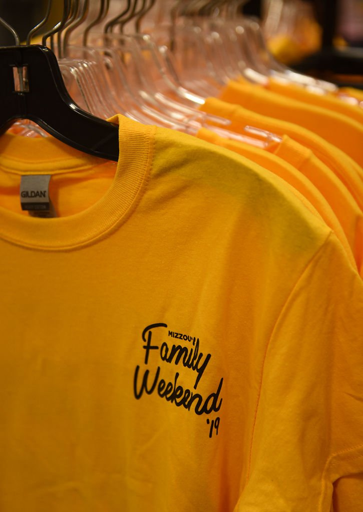 Family Weekend 2019 T-shirts sit on racks in the Mizzou Store in the MU Student Center