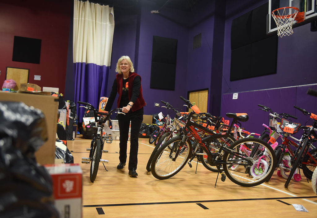 Volunteer Barb Elmore walks through the gym at Woodcrest Church