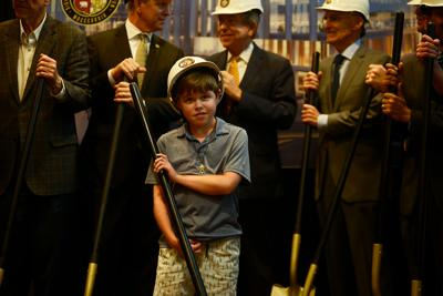 Mark McDonald, 14, waits shovel in hand for the official groundbreaking to start during the ceremony