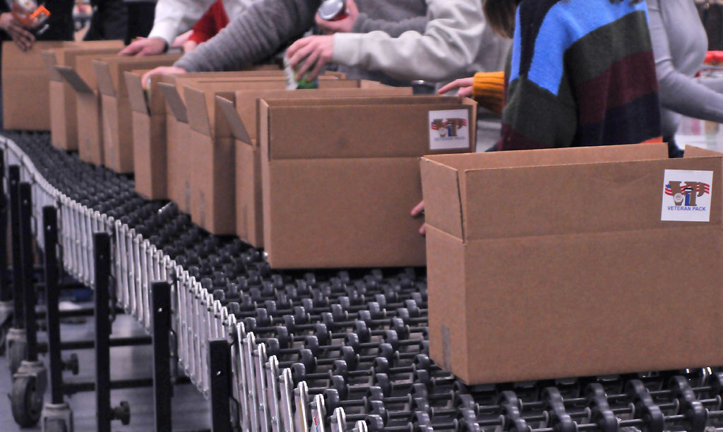 A line of packages gets pushed down the conveyor belt