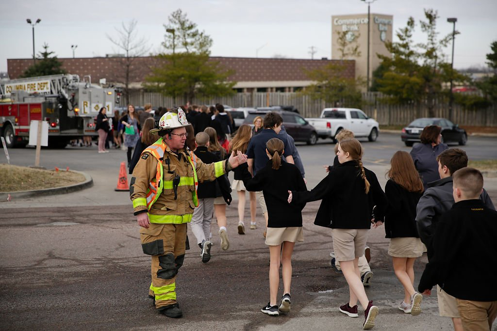 Students high-five Captain Tim Taylor