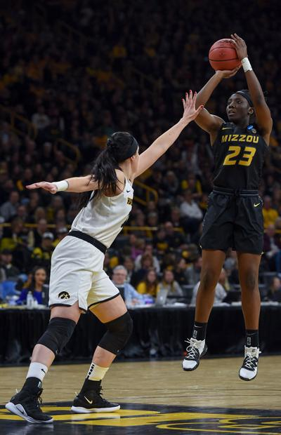 Missouri guard Amber Smith goes up for a jump shot