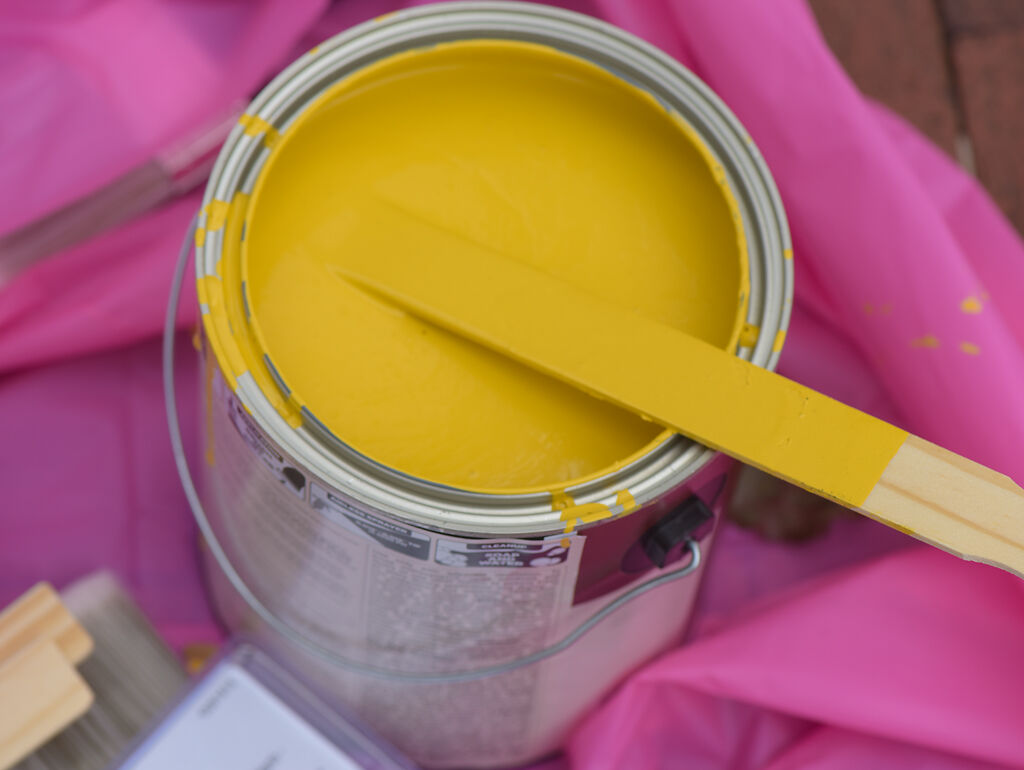 A bucket of yellow paint