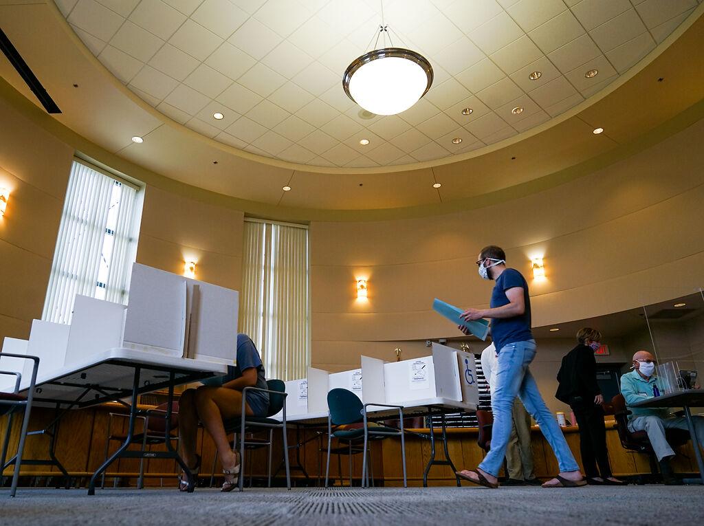 John Fifield walks toward a voting station