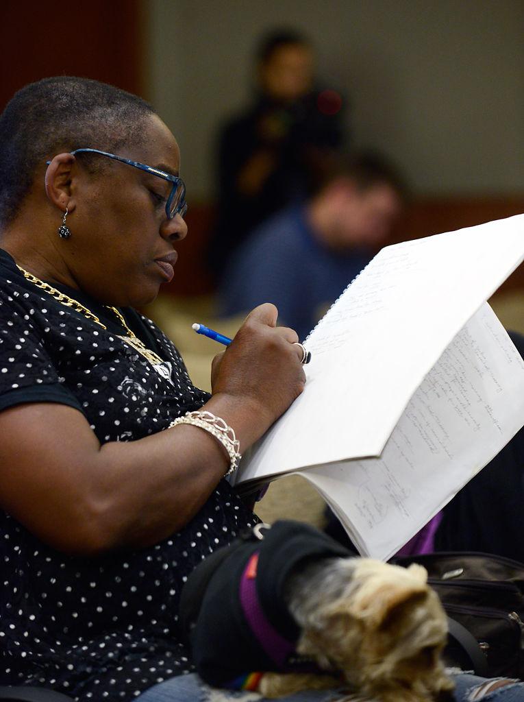 Audience member takes notes during police bias training