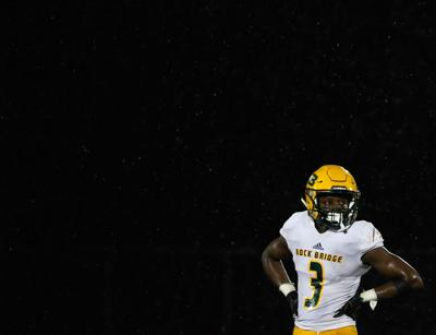 Martez Manuel, a wide receiver for Rock Bridge High School, rests in between plays