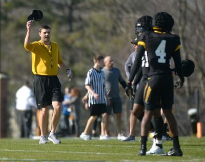 Missouri recruiting coordinator Casey Woods takes off his hat
