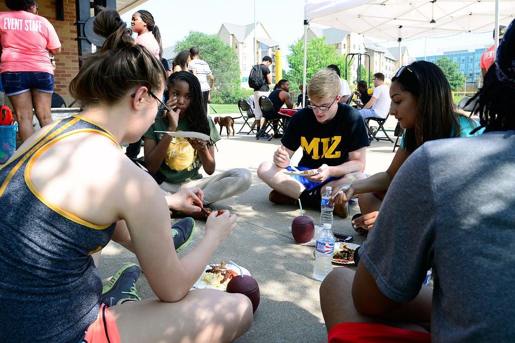 University of Missouri community advisers eat at the Beach Bash