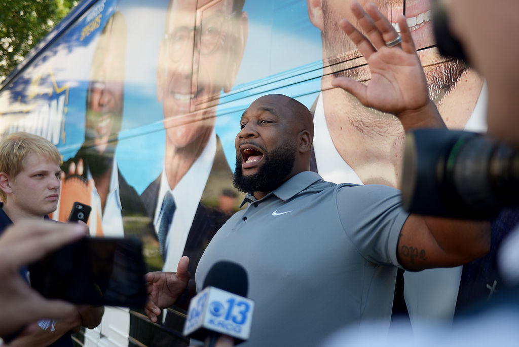SEC Analyst Marcus Spears speaks with reporters