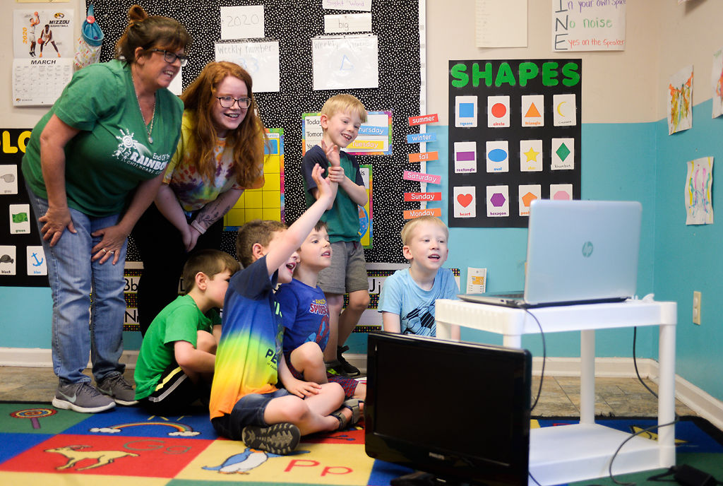 Children in class talk to their friends over Zoom