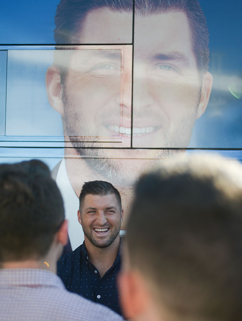 SEC Analyst Tim Tebow speaks with reporters