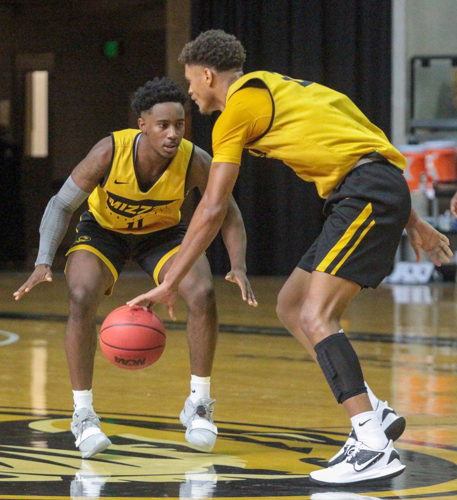 Freshman guard Mario McKinney Jr., left, defends freshman forward Tray Jackson
