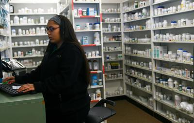 Pharmacy Technician, Lexi Butler fills a prescription order