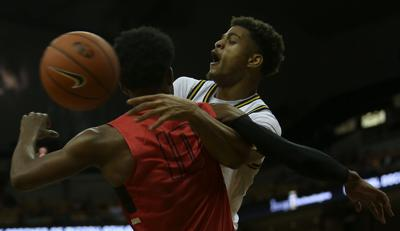 Missouri forward Tray Jackson collides with Central Missouri guard Joshua Greer under the basket at the MU basketball exhibition game against CMU