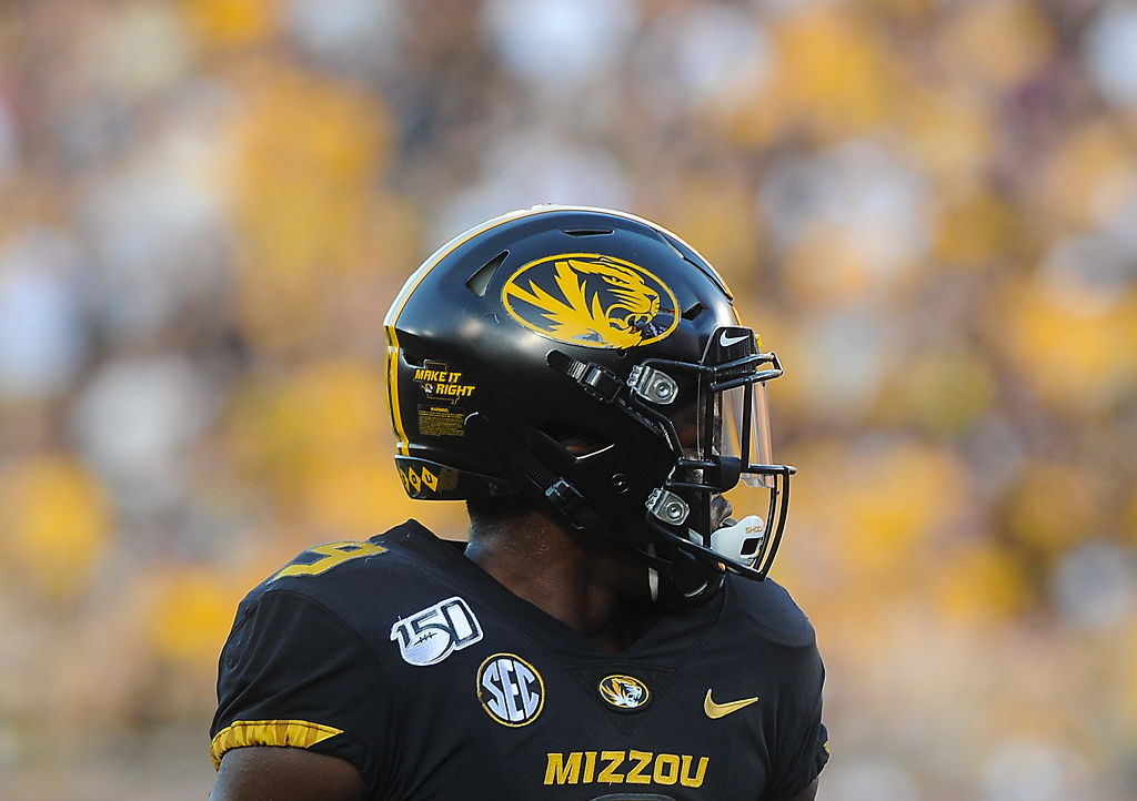 "As part of Missouri's ""Make it Right"" campaign, athletes wore a sticker for the campaign on the backs of their helmets"