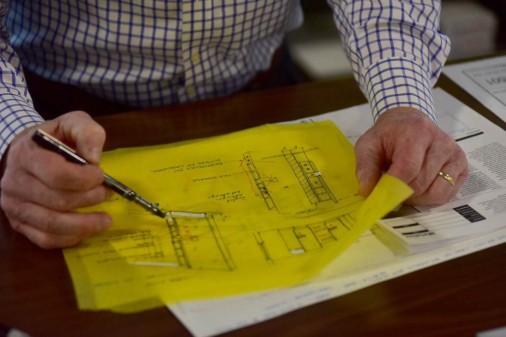 Commercial architect Robbie Price looks over designs for a salon renovation