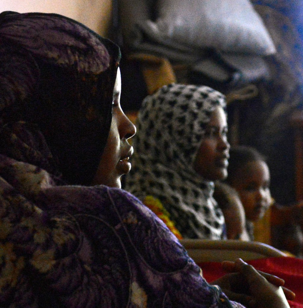 Ramla Abdi and her family sit on the couch