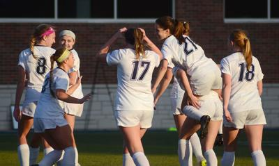 Columbia College women's soccer team celebrates after their 2-1 win against Missouri Valley College