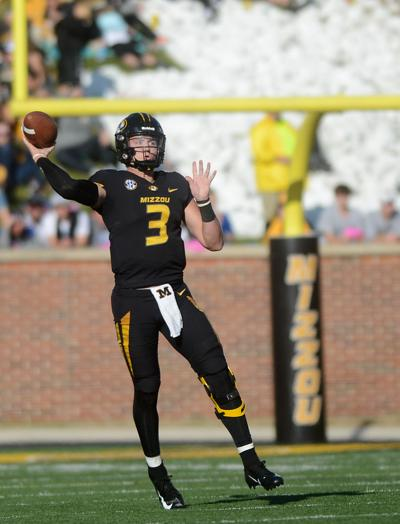 Missouri quarterback Drew Lock makes a pass against Kentucky