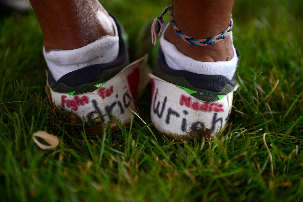 The shoes of Battle High School cross country runner Micah Stevens bear the name of Nadria Wright
