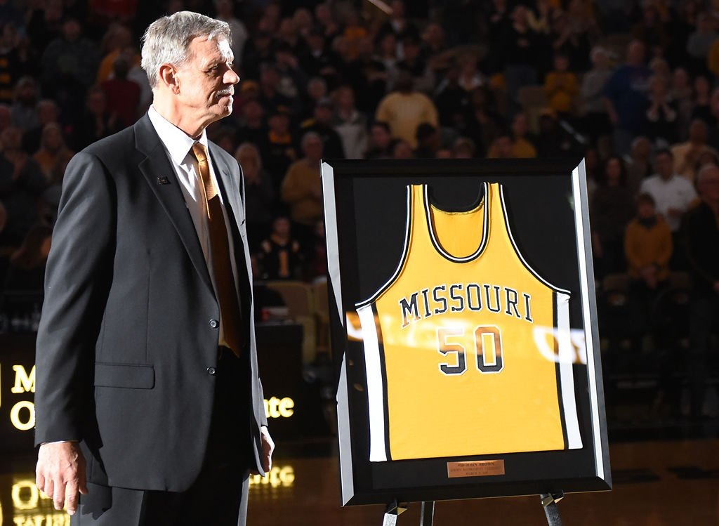a74d4c36e3d Former Missouri basketball player John Brown stands before his old jersey