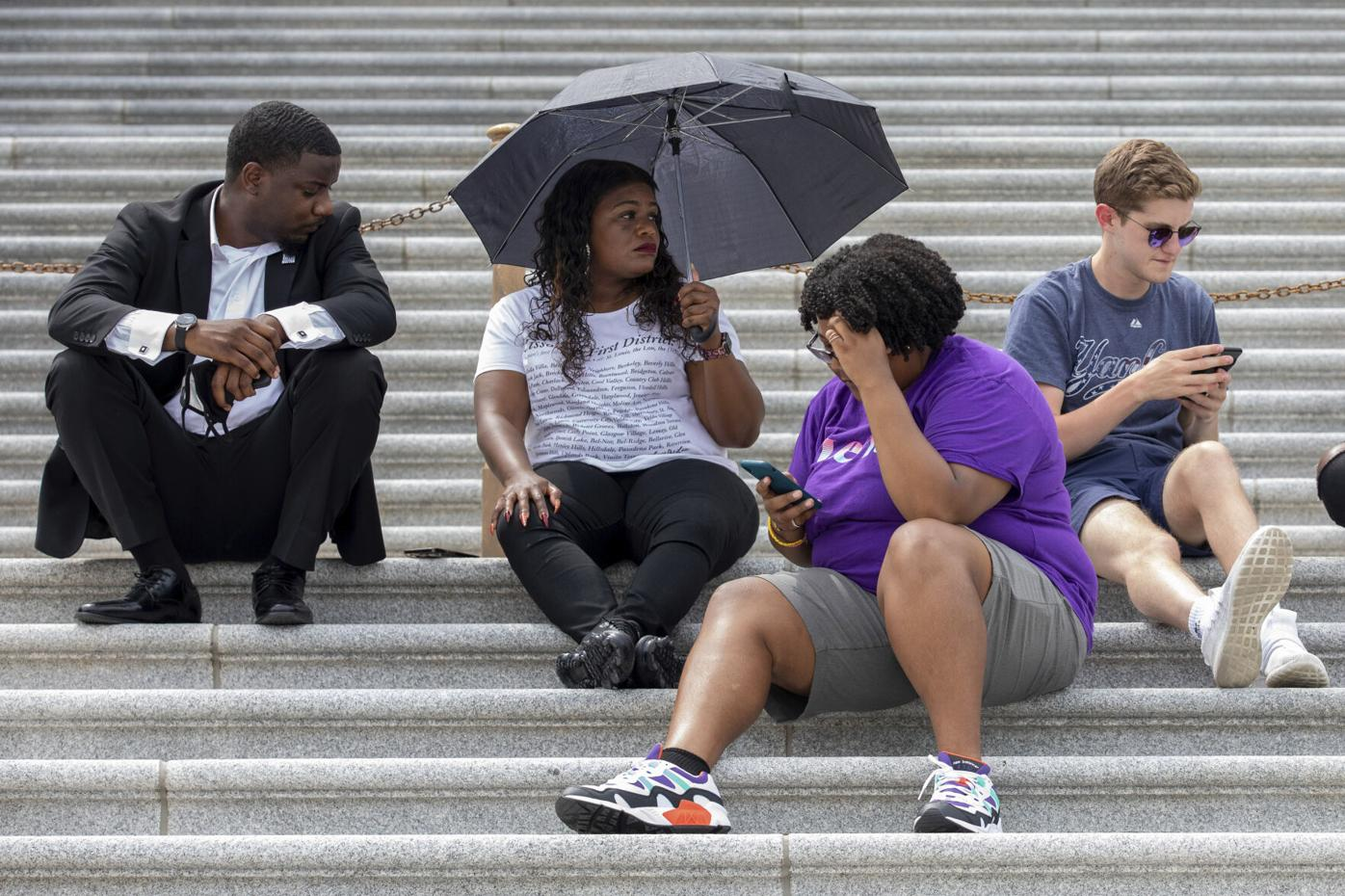 Cori Bush sits on U.S. Capitol steps during protest of eviction moratorium