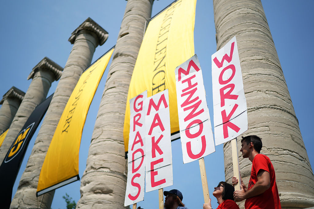 The Coalition of Graduate Workers gathers at the MU columns on Wednesday