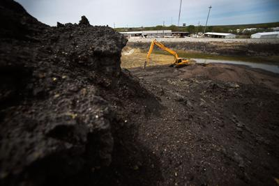 More's Lake sits hidden behind mounds of coal ash (copy)