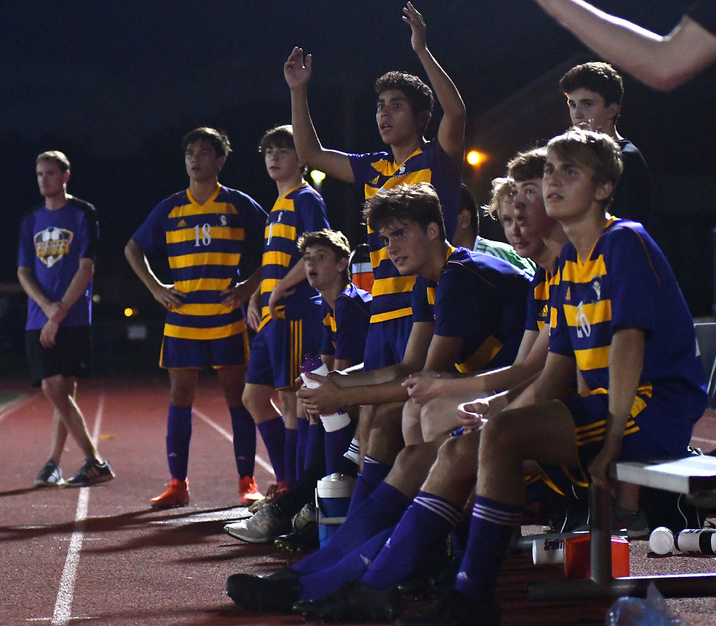 Hickman soccer players react to a call
