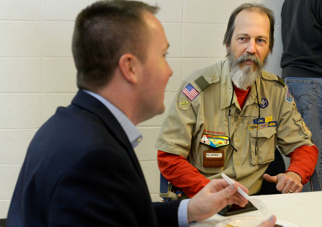 Scoutmaster Hal Johnson talks to John Fabsits