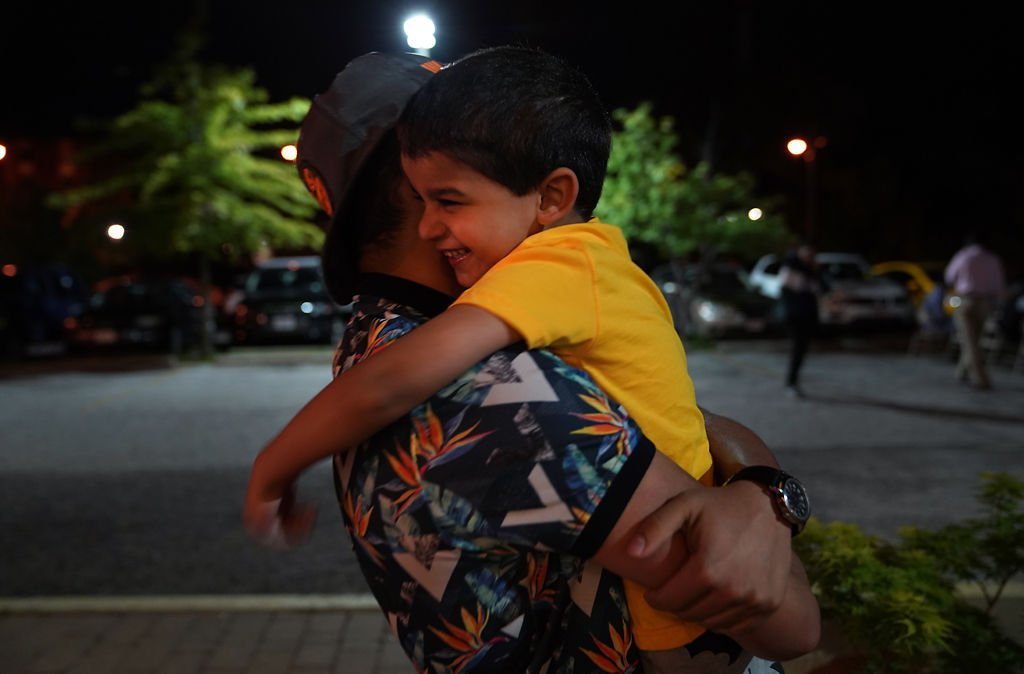 Mohamed Baqer Al Hraishawi, 4, jumps into his 15-year-old brother Hussein Al Hraishawi's arms