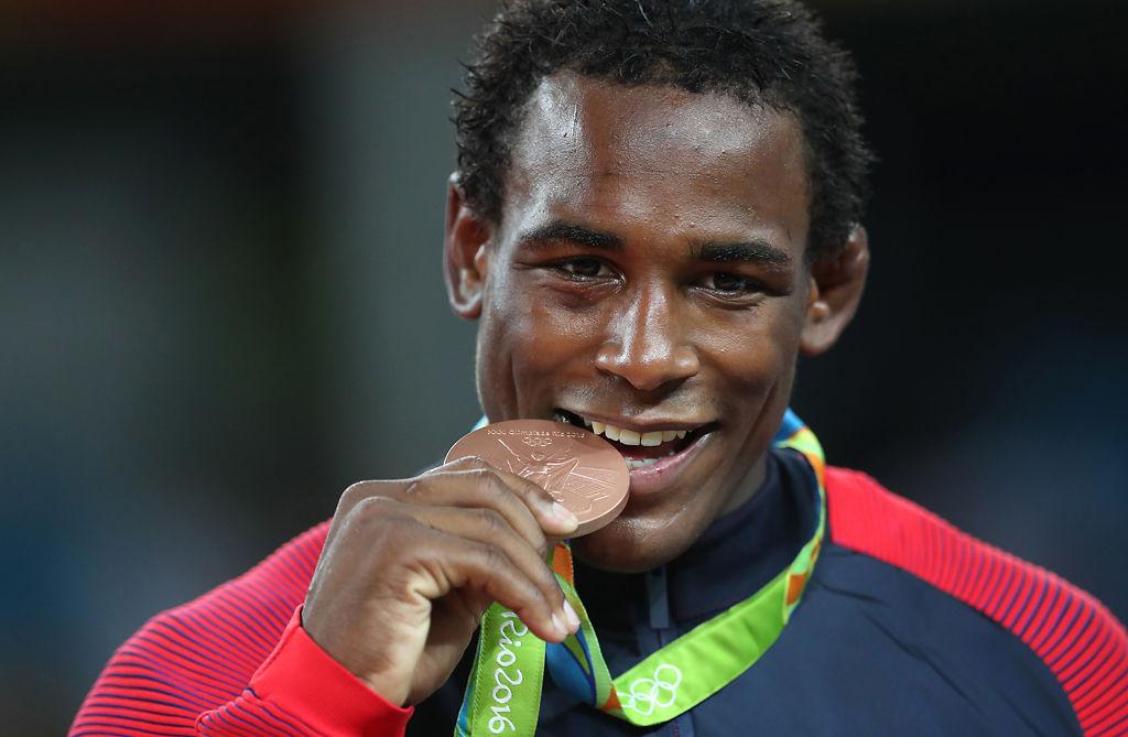 J'den Cox bites his Olympic medal (copy)