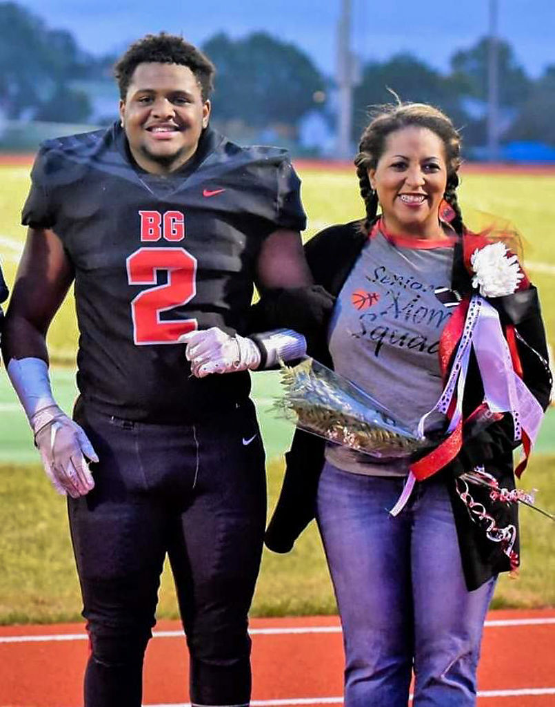 Kaleo Dade, left, stands with his mother, Tiffany Coleman-Dade, during Davis' senior night recognition