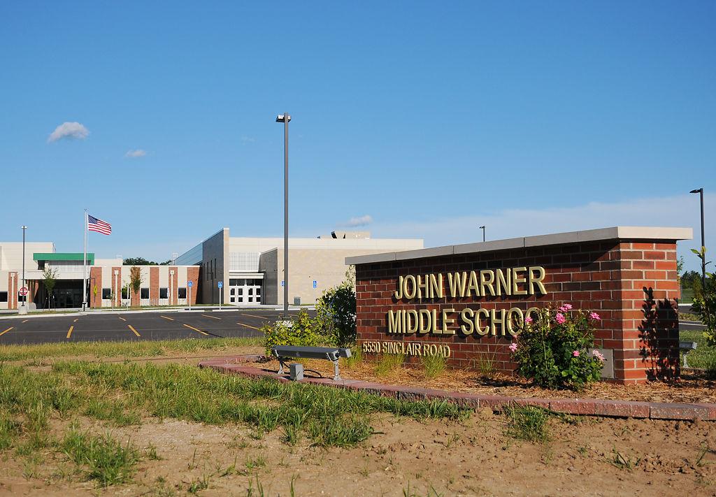 A sign outside John Warner Middle School