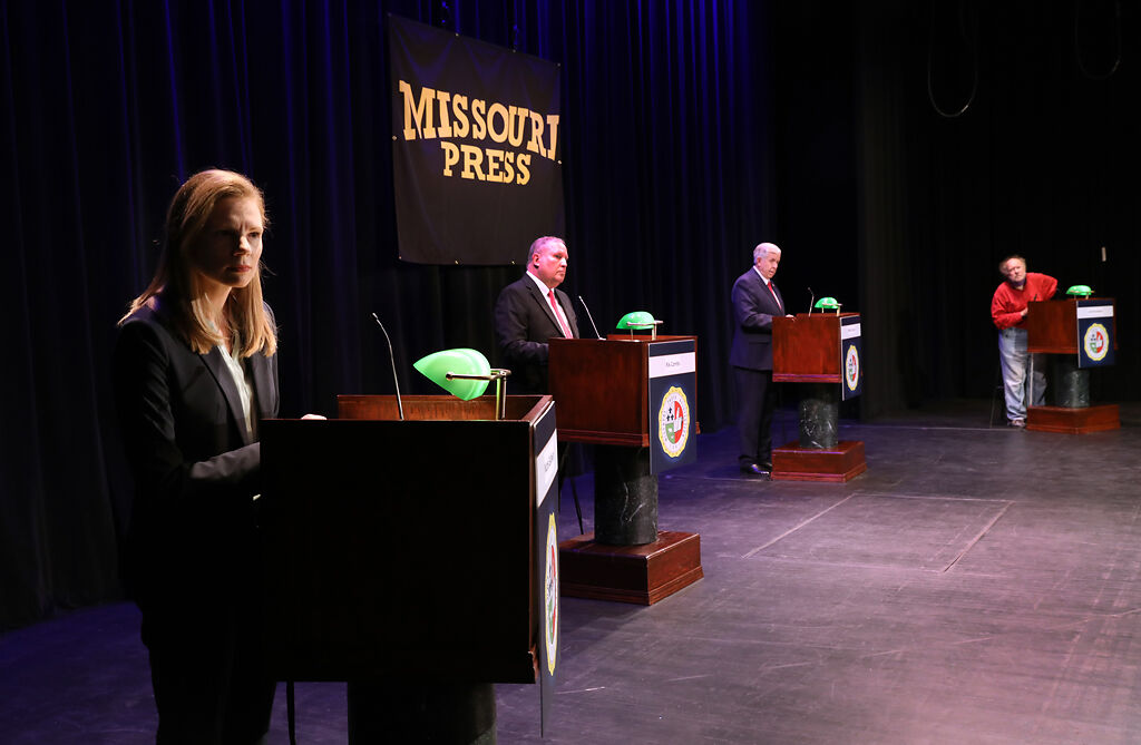 Candidates State Auditor Nicole Galloway, Libertarian candidate Rik Combs, Gov. Mike Parson, and Green Party candidate Jerome Bauer listen to a question