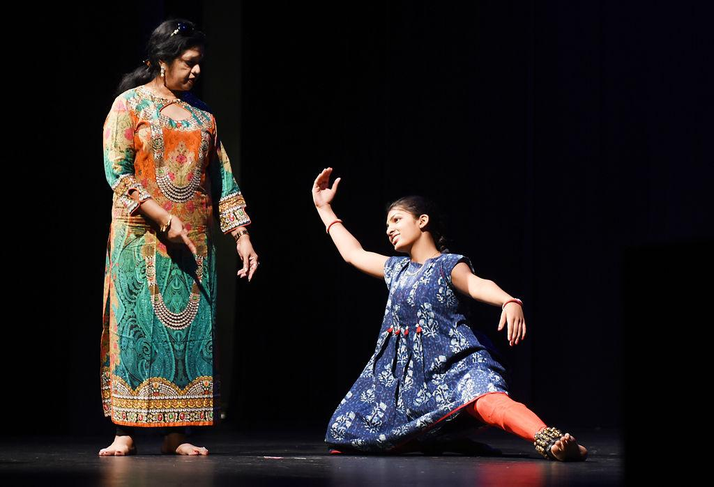 Teen graduates from local Indian dance school with colorful