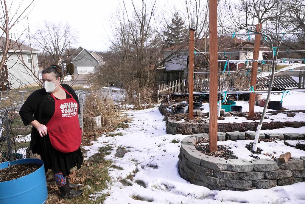 Laura Flacks-Narrol stands before one of her garden beds